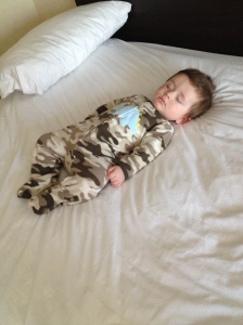 Bed hog - fast asleep while Mom & Dad get ready for the day