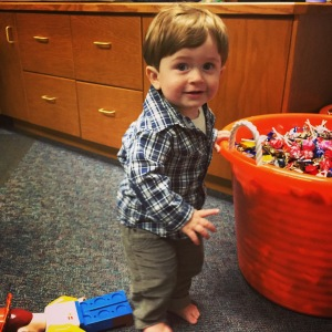 Checking out the candy for Fall Fest in Daddy's office
