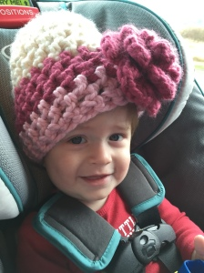 Wearing Mommy's hat on the way back from getting our tree