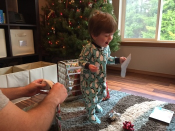 "This picture sums us Owen's love for Christmas - ""I have a piece of wrapping paper!"""