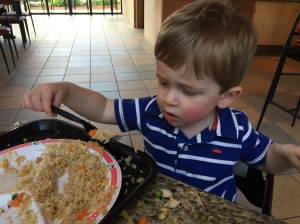 This boy loves his rice!