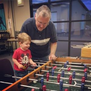 Playing games with Papa at church