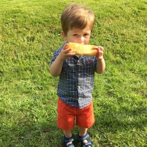 A boy and his hot dog bun