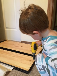 Helping Daddy build with his new drill