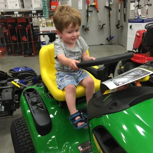 Hanging out at Lowes while waiting to meet Bennett. Owen really loved the riding lawn mowers.