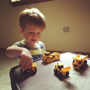 Playing with a new assortment of construction vehicles