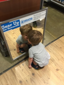 Kissing his reflection in the shoe department of the Columbia Outlet