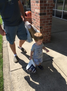 It was hard to get a good picture, but here is Owen walking around with his very own shopping bag. He really got into the shopping experience!