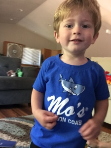 Owen is obsessed with this shark shirt from our vacation. He requests to wear it and cries when we take it off. He has the same reaction to any clothes that have trucks on them.