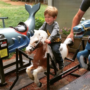 "Enjoying the plastic ""neigh neigh"" at Lattin's Cider Mill & Farm"
