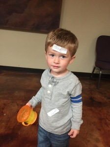 At the MOPS social, Owen put Harper's name tag on his forehed and would not let it be taken off. Not a great pic for smiling, but the silly memory was documented!