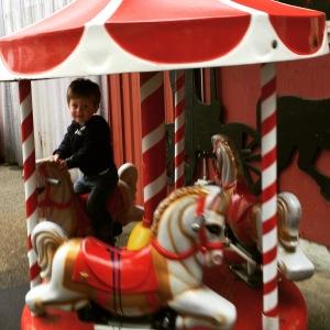 """Enjoying a """"pony ride"""" at the farm"""