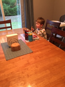 Eating breakfast at the table like a big boy