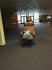 Playing with Nana at church! Chair rides are so much fun!