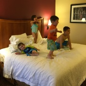 Monkeys on the bed, ready to go swimming!